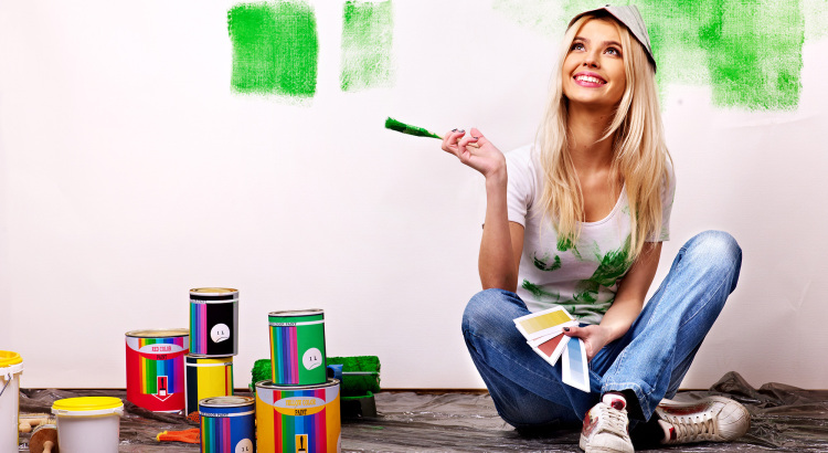 Happy woman painting home