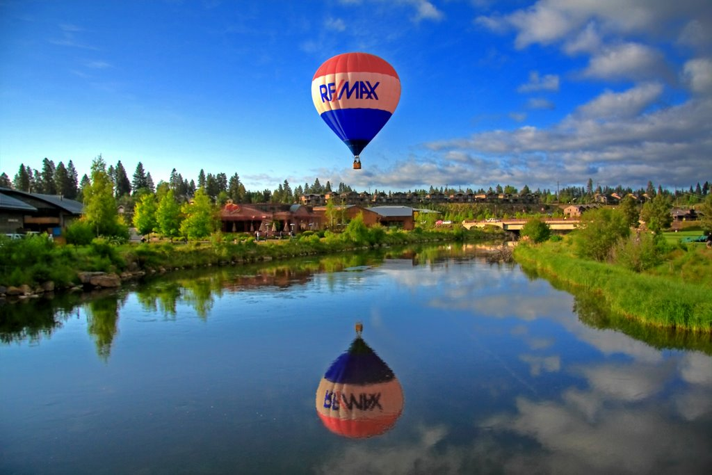 REMAX Ballon flying over a lake